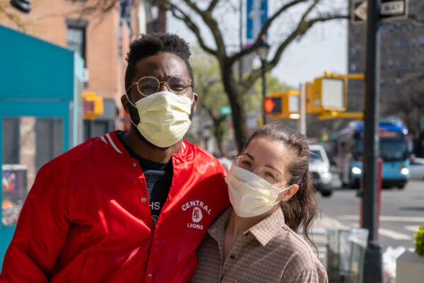 Two people with face masks on