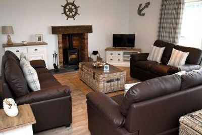Living room with three leather sofas